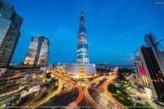 Lotte World Tower at Night Seoul, South Korea. Lotte World Tower at Night. Cityscape of Songpagu district, motion blurred traffic lights, illuminated skyscrapers and Lotte World Tower. Seoul, South Korea, Asia. Download Photo : http://www.istockphoto.com/photo/cityscape-songpagu-skyscrapers-lotte-world-tower-at-night-seoul-gm613254398-105842387