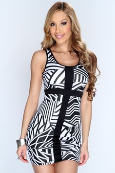 This fancy dress will definitely grab anyones attention in the club or at any party! This one of a kind dress is stylish and chic. Wear this out with your gals or even on a romantic date with that special someone. This dress features scoop neck, sleeveless style, two tone, printed and tight fitted to show off your sexy curves you have. 95% Polyester 5% Spandex Made in U.S.A.