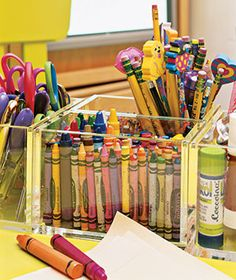Use Clear Boxes    For scissors, glue sticks, crayons, and the like, Lucite or other plastic containers provide smart storage and consolidation (no more forcing crayons back into a disintegrating cardboard box to make a matched set). Kids can easily see what each container holds, and they can find the right shade of green at a glance and put back what they've taken out when they're done.
