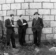 Celebrating the first ever Bloomsday on Wednesday, 16th June 1954 - Anthony Cronin, John Ryan and Patrick Kavanagh at the Martello Tower, Sandycove, Dublin. NLI ref.: WIL pk 11(9)
