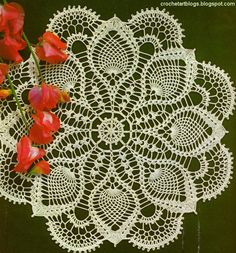 Magic crochet Doily Free  the wagon wheel center is so cool. PLUS... I LOVE the  Pineapple shape