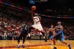 MIAMI, FL - NOVEMBER 15: LeBron James #6 of the Miami Heat shoots against the Dallas Mavericks on November 15, 2013 at American Airlines Arena in Miami, Florida.