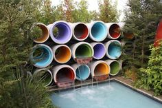 An award winning exhibition garden displayed at Ellerslie International Flower Show held in Christchurch, New Zealand. Water flows from a bank of brightly painted recycled concrete pipes along the back wall, cascading into the canal water feature. The water feature represents the network of canals that traverse the Mackenzie landscape carrying large volumes of water to the various hydro lakes and power stations.   https://lnkd.in/evHMjR4 #Forterrabp #Concrete #Precast