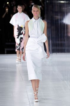"S/S 2014:: PRABAL GURUNG  ~~  Unique ""origami"" effect  --  clean, structured shapes; bow detail, mint green shoulder corners, crisp collar.  I really love this. Credit: Getty @Huff Post Style"
