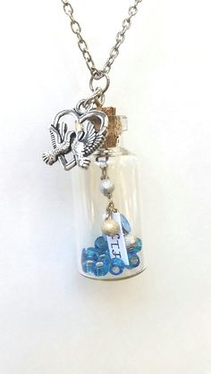 message in a bottle necklace, charm necklace, message in a bottle jewelry, dove charms, dove pendants by Cthruglass on Etsy