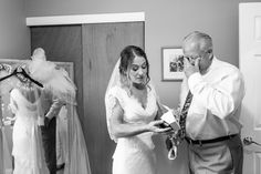 Father of the bride tears up as bride opens the gift he gave her on her wedding day