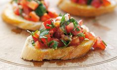 Bob's Bruschetta (gluten free, vegan)  3 fresh diced tomatoes 4-6 cloves garlic 6-7 large fresh basil leaves Sea salt and pepper to taste Balsamic vinegar and Olive oil to taste Mix and allow to marinate. The longer it sits, the more infused the flavor becomes! Serve over favorite grilled gluten free bread or over …