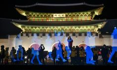 """Dozens of """"ghost protesters"""" appeared in the South Korean capital Wednesday in a demonstration against curbs on public meetings, despite police threats of a ..."""