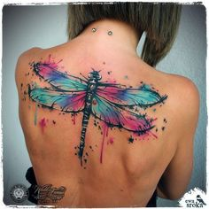 Splashy watercolor dragonfly tattoo by Ewa Sroka