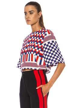 Alexander McQueen has used geometric in some of his designs. Although it is a simple cut top, the use of a geometric pattern gives it and edge and different shape to the garment.