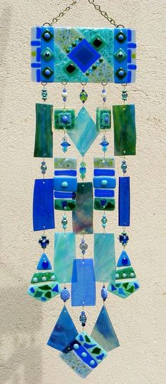 Kirks Glass Art Fused Stained Glass Wind Chime - The Blues. This is EASY to make - get small sheets of glass from the craft store, glass cutters, wire, beads...