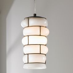"""Milk Glass Caged Pendant This pretty cottage style pendant will add a warm and charming touch over a kitchen island or sink. The white milk glass will provide soft diiffused lighting. (10""""Hx5""""W)."""