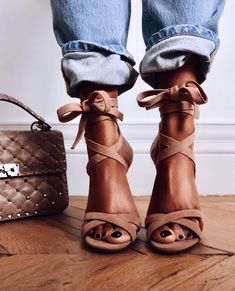 Cute tan laced shoes with denim jeans.