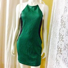 PRICE DROP Green, black, cream bodycon dress Beautiful and would love to keep but it doesn't fit me very well. Really comfortable and new! Forever 21 Dresses