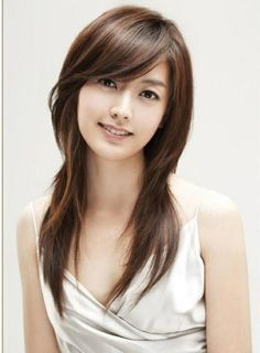 Long Layered Hairstyles with Side Swept Bangs