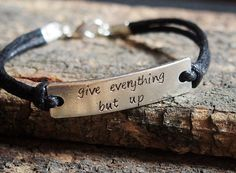 This is the example photo of showing my hand stamped Quote bracelet in black leather, silver metal bar by vintage alloy raw material. I can accept
