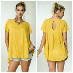 Mustard Tunic Soft, circle shaped tee ; features a cutout in back pleat detail  Fabric: cotton/slub Tops Tees - Short Sleeve