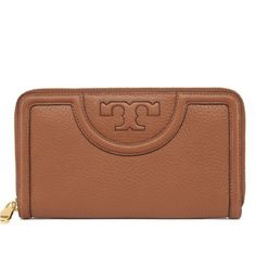 """NWT Serif T Continental Zip Wallet Tory Burch Clean lines, a versatile shape and multiple pockets — finished with a graphic tonal logo. The Serif-T Zip Continental Wallet is made of rich pebbled leather, with a classic long silhouette that fits all full-length bills without folding. It's a great everyday organizer.  DETAILS & FIT Zipper closure 8 interior credit card slots, 2 compartments, 2 bill pockets, 1 interior zipper Length: 7.65"""" (19.2 cm) Height: 4.30"""" (10.8 cm)   Pebbled leather…"""