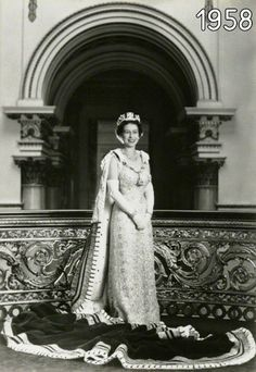 HM Queen Elizabeth II at the top of the Grand Staircase, Buckingham Palace