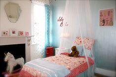This big girl room is too sweet! We love the vintage paper doll wall art. #biggirlroom