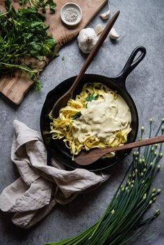 chickpea alfredo with watercress & chives   two red bowls