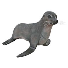 The Baby Fur Seal Statue. Did you know that fur seals can walk on all fours? Though this one prefers to stay in one spot, our over-two-foot-long, almost-life-size baby seal statue is sculpted in amazing detail, then cast in quality designer resin and hand-painted from its small, pert ears to its generous flippers. #seal #statue #poolside