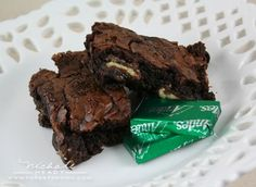 Andes Mint Brownies - a box of brownie mix + its added ingredients and a package of Andes Mints. That's it! Pour half of the prepared batter in a 9 inch pan, layer the unwrapped candies in the middle, and pour the rest of the batter on top and bake according to brownie mix package directions.