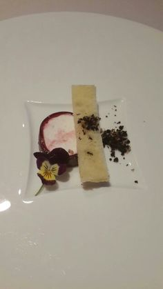 Goat chesee wrap in beetroot jelly ,croutong n olive powder  Amuse