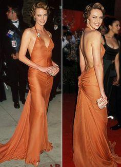 Who: Charlize Theron   What: Tangerine Vera Wang dress.  Where: Oscars 2000