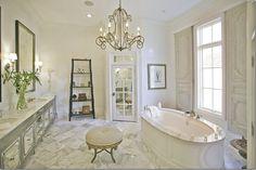 Like the idea of putting mirror in the door panels. Master bath idea.