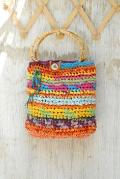 Colorful crocheted purse with bamboo handles, Joyful summer handbag with wooden beads and a button
