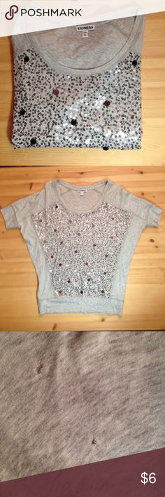 Express Sequin Shirt Express Sequin Shirt - Gray with silver sequins - Only worn a few times - small holes in right sleeve (price reflects this) Express Tops Blouses