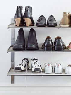 Shoes stored on GRUNDTAL towel hanger/shelf in stainless steel