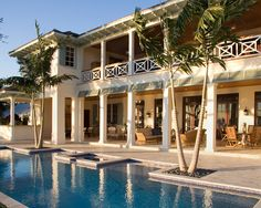 Two story loggia bungalow style British West Indies Residence - traditional - pool - other metro - Village Architects AIA, Inc.
