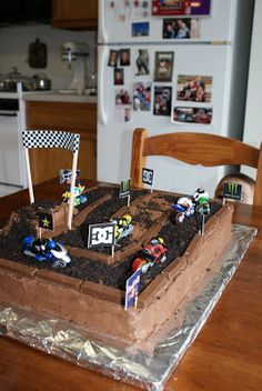 This Cake was so much fun to make. My neighbor and friends son, Ethan turns 5 this week. They came up with the idea to make a cake into a di. Bike Birthday Parties, Dirt Bike Birthday, Monster Truck Birthday, 4th Birthday, Motocross Birthday Party, Motorcycle Birthday Cakes, Birthday Ideas, Dirt Bike Cakes, Dirt Bike Party