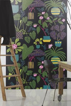 A fun, bold giant scale pot plant wallpaper panel design with stylised green leaves on a deep black background.