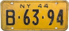 An antique 1944 New York WWII License Plate, this NY tag is yellow in color with black letters with a simple design of NY 44 both at the top. License Plates, Black Letter, Simple Designs, General Store, New York, 50 States, United States, Wwii, Antiques