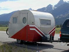 silver and red vintage camper. I'd love to have one of these!
