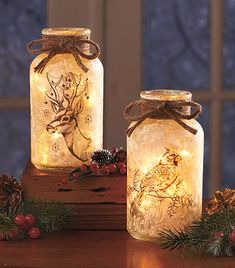 Celebrate the season with this decorative glass mason jar featuring a woodland creature and a frosted look. The warm-toned glass looks like it was touched by Jack Frost. Snowy foliage and soft lights inside give it a wonderful glow.