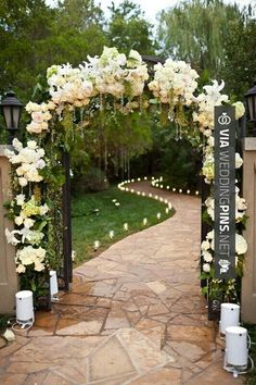 Wedding Decor Trends 2016 Wedding Decorations ~ Ceremony floral Arch and candles for an outdoor ceremony- For more great inspiration visit us at Bride's Book home of the VIB Bridal Club Wedding Reception Entrance, Ceremony Arch, Outdoor Ceremony, Wedding Ceremony, Wedding Venues, Wedding Church, Wedding Ideas, Wedding Arches, Church Ceremony