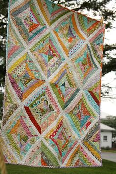 bummed I didn't actually find this quilt on the link but it is just a strip quilt. I just like the colors together.