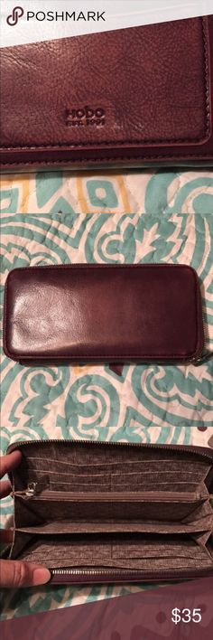 Authentic Hobo wallet Excellent used condition. Distressed purple leather. Inside is perfect. Only flaw is three small silver spots on the back (see last pic) that I wasn't aware was there until taking pics for this listing. I haven't tried to remove them so, it's possible they could be removed. HOBO Bags Wallets