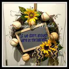 """""""If we don't answer we're at the ballfield"""" vine, baseball, & sunflower wreath. Blue & burlap chevron bow with raffia. Chalkboard sign with permanent v"""