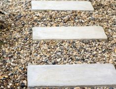 """Pea gravel for a """"potty spot"""" inside a dog run. It's inexpensive, drains well, pretty attractive, safe for dogs (though, be aware of dogs who try to swallow rocks)"""