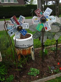 Old license plate flowers for garden