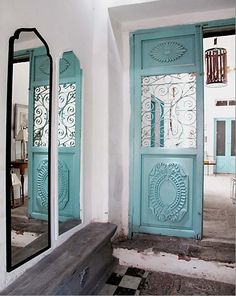 pretty door via Meryll Bigalbal - this gives me the idea to use really ornate decorative frames and apply them w/liquid nails to doors to up their juicieness factor.
