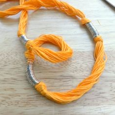 A new use for embroidery thread? Love this, pair with some silver chains and call it love.