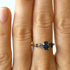 One of a kind stone cluster ring with a .98 carat oval cut deep blue sapphire, flanked with dark blue green bicolor sapphires set in 14k yellow gold. This baby is SOLD but we have more new one of a kind pieces coming soon. To be the first to know email mociun@mociun.com #mociun #mociunoneofakind #mociunjewelry #sapphires