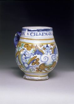 "1642 Mug at the Victoria and Albert Museum, London - From the curators' comments: ""This type of mug was made by London delftware potters in the second quarter of the 17th century. Containing about half a pint of liquid, it may have been intended for strong beer which, in the general absence of wine, was a drink equally favoured by women. But its primary role was probably as a commemorative piece for display."""