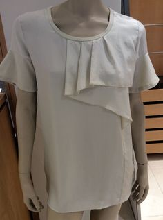 SS 2014 Collection: Maxmara weekend beige cotton t-shirt with frill detail.  Price on request.